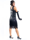 A Black Flapper Dress with black sequins, silver beads and fringes around the hem - Back View