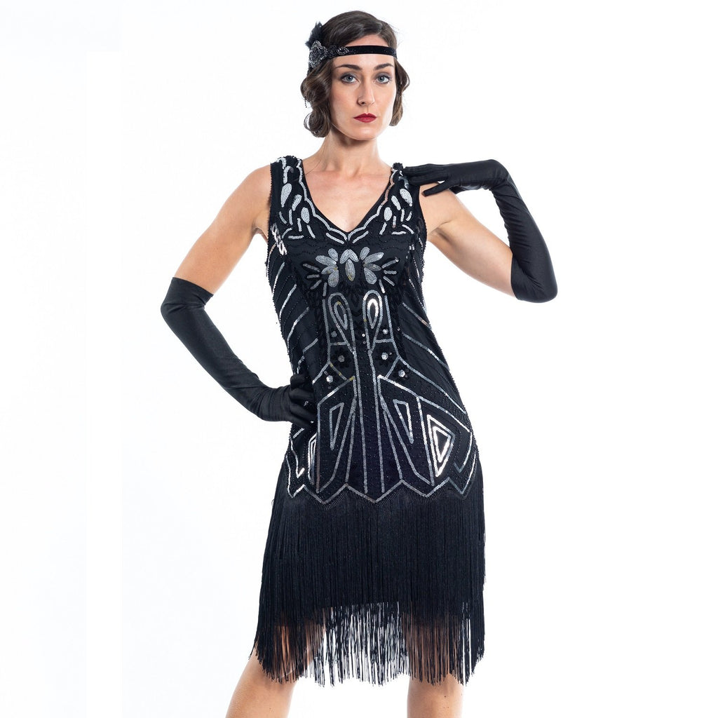 A Black Flapper Dress with black sequins, silver beads and fringes around the hem - Close View