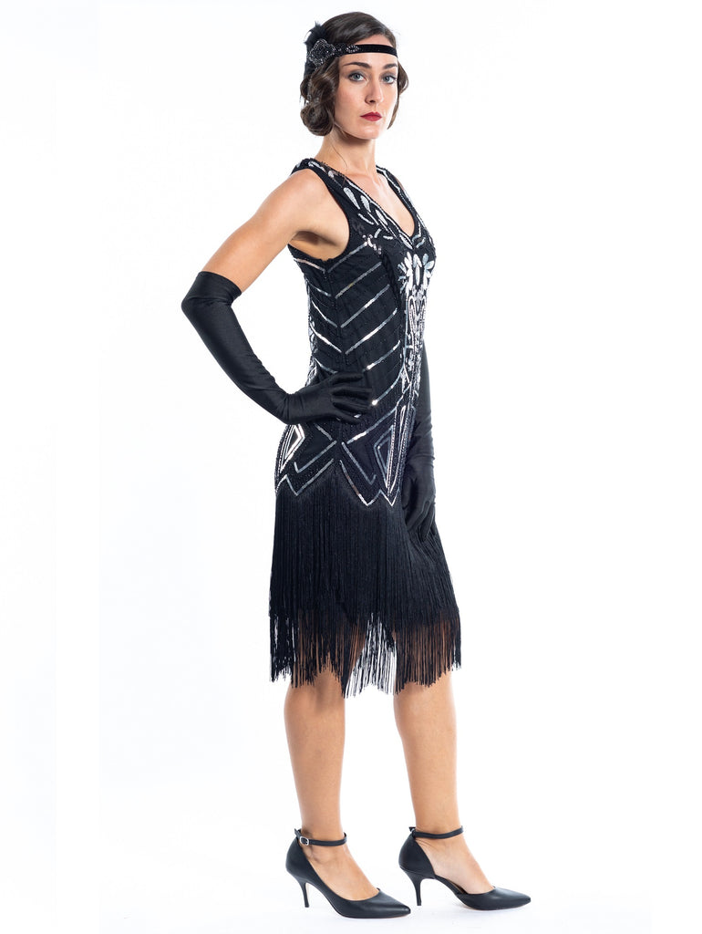 A Black Flapper Dress with black sequins, silver beads and fringes around the hem - Side View