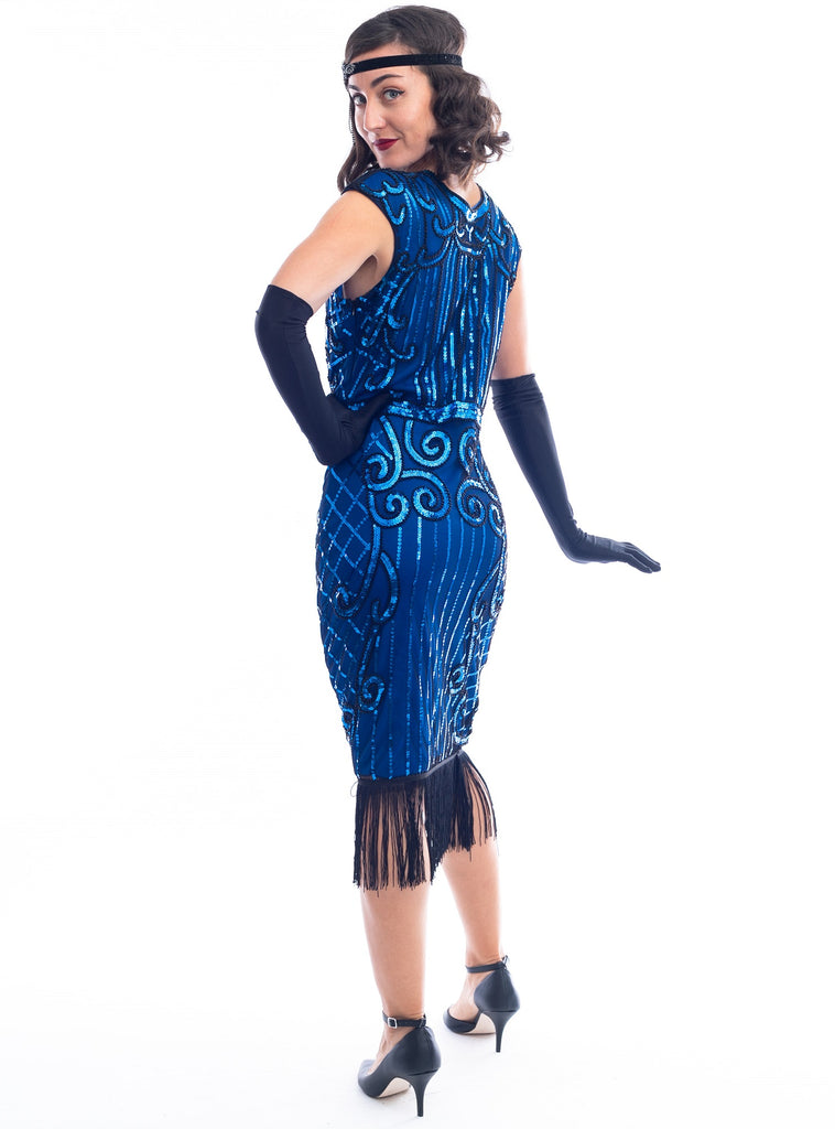 A side view 1920s Blue Flapper Dress with blue sequins, black beads and fringes around hem