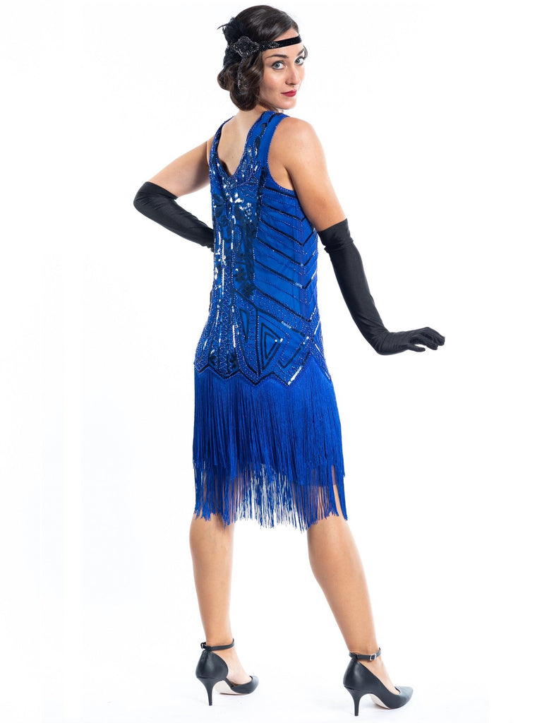 A blue flapper dress with sequins, beads and fringes around the hem - Back View