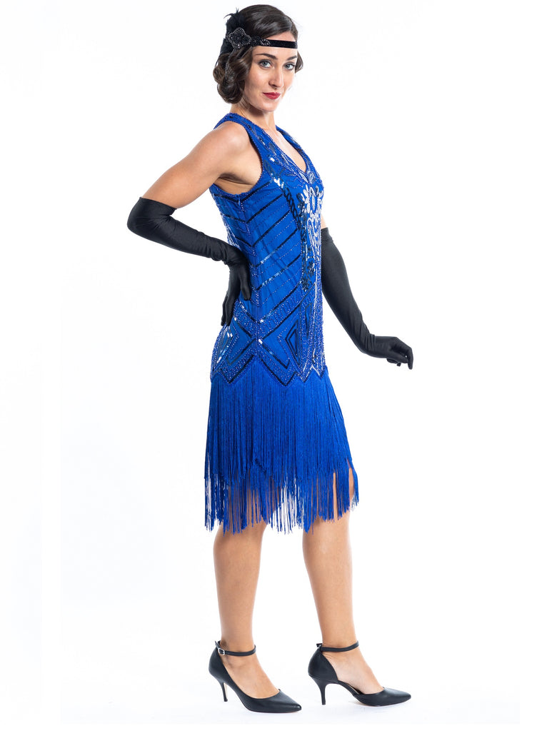 A blue flapper dress with sequins, beads and fringes around the hem - Side View