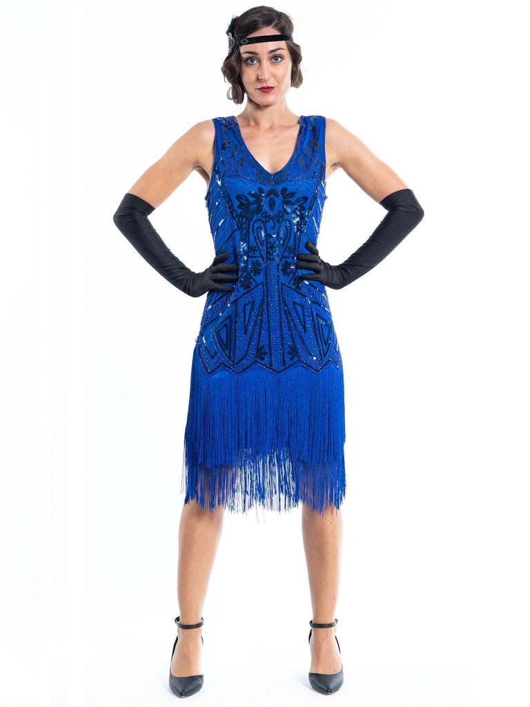 A blue flapper dress with sequins, beads and fringes around the hem