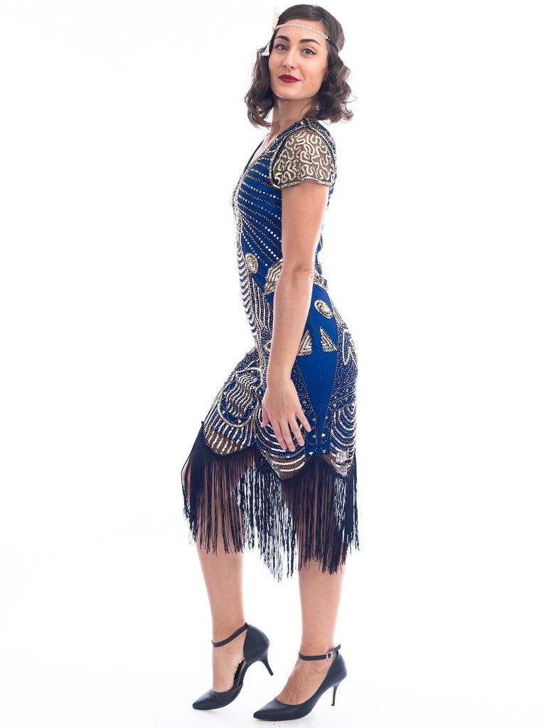 A side view 1920s Blue Gatsby Dress with gold sequins, gold beads and fringes around hem