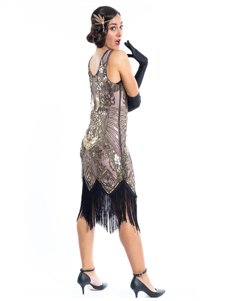 A vintage 1920s gatsby dress that is cashmere in colour