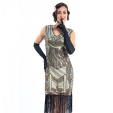 A gold flapper dress with a 1920s deco pattern of sequins, beads and fringes around the hem - Close View