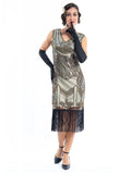 A gold flapper dress with a 1920s deco pattern of sequins, beads and fringes around the hem