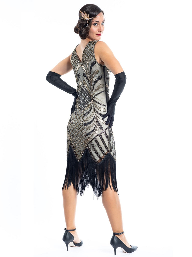 A vintage flapper dress with gold sequins, gold beads and fringes around the hem - Back View