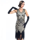 A vintage flapper dress with gold sequins, gold beads and fringes around the hem - Close View