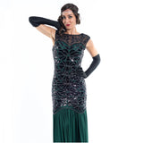 A long green flapper dress with black sequins and beads