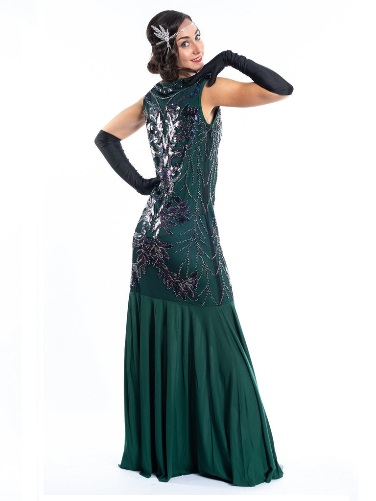 A long green gatsby dress with black sequins and beads