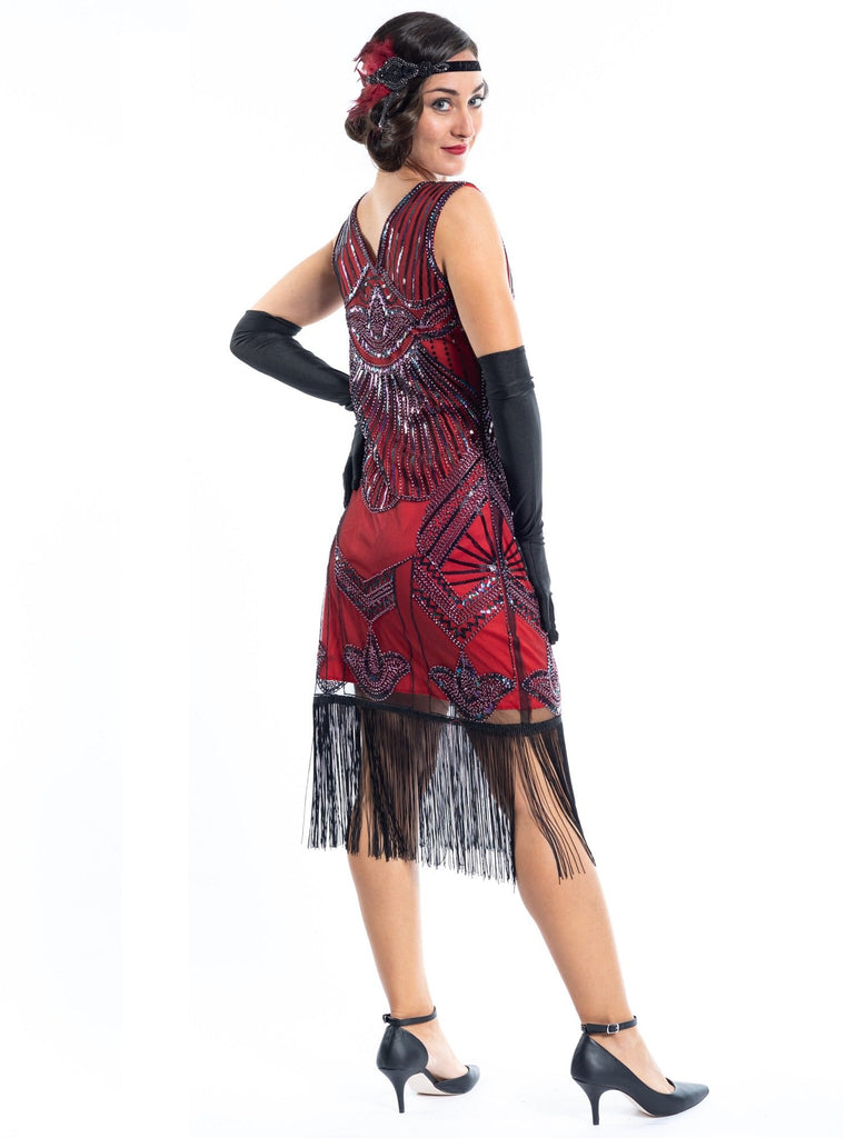 A red flapper dress with a 1920s deco pattern of sequins, beads and fringes around the hem - Back View