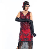 A red flapper dress with a 1920s deco pattern of sequins, beads and fringes around the hem - Close View