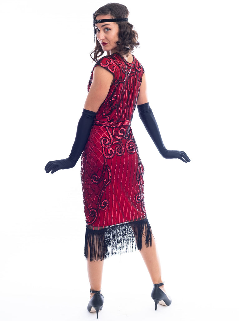 A back view of a Red Flapper Dress with a cocktail and deco pattern of red sequins and black beads.