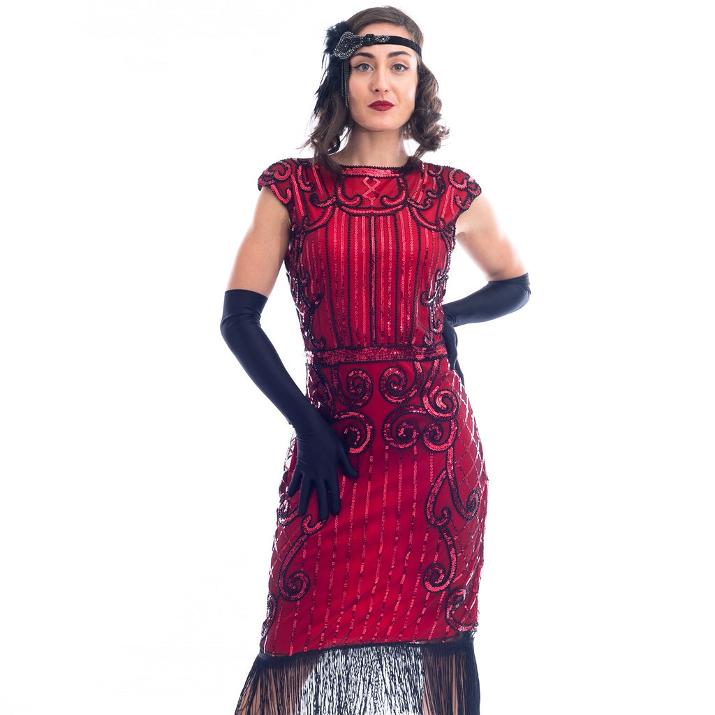 A close view of a Red Flapper Dress with a cocktail and deco pattern of red sequins and black beads.