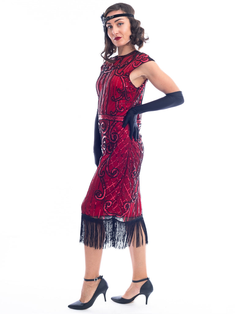 A side view of a Red Flapper Dress with a cocktail and deco pattern of red sequins and black beads.