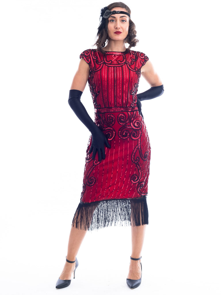 A Red Flapper Dress with a cocktail and deco pattern of red sequins and black beads.