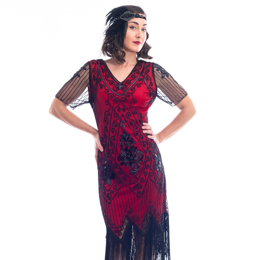 A close view of a burgundy red 1920s Flapper Dress with black beads, sequins, sheer sleeves and black fringes