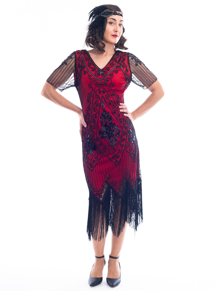 A burgundy red 1920s Flapper Dress with black beads, sequins, sheer sleeves and black fringes