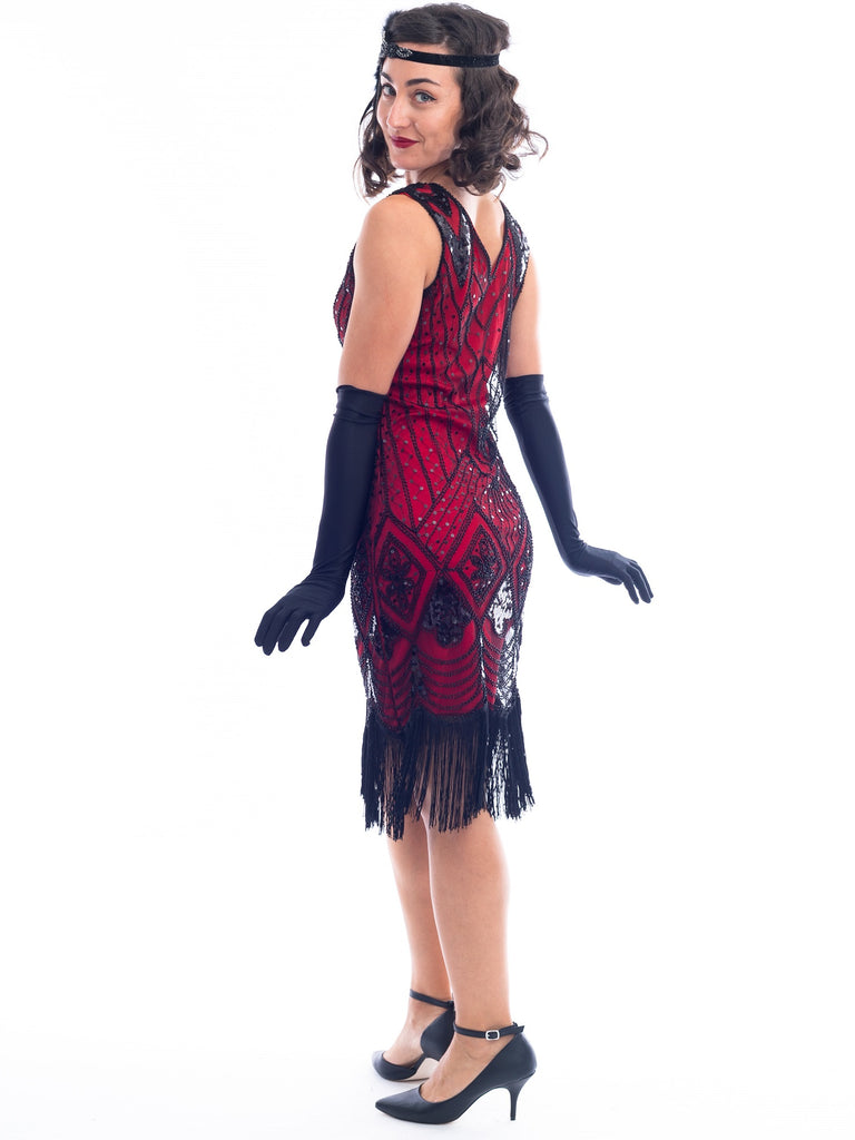 A back view of a Red Gatsby Dress with deco pattern of black sequins and beads.