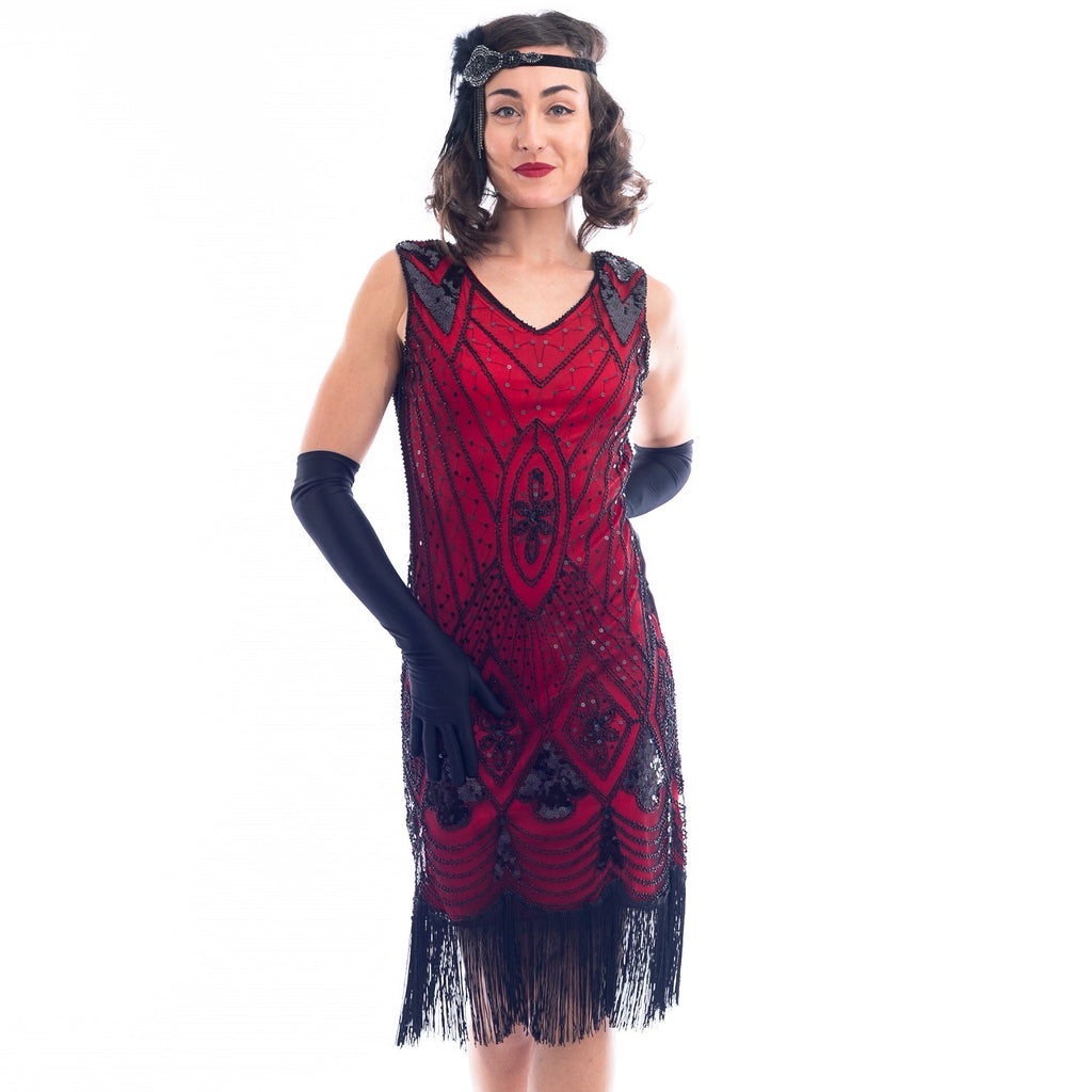 A close view of a Red Gatsby Dress with deco pattern of black sequins and beads.