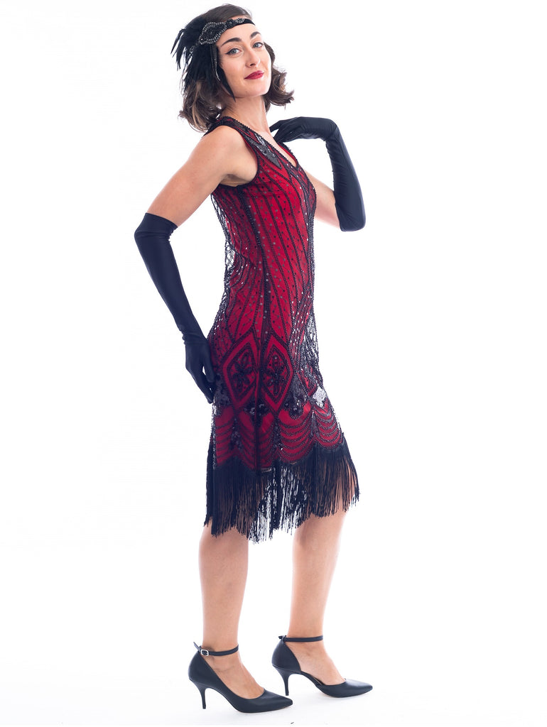 A side view of a Red Gatsby Dress with deco pattern of black sequins and beads.