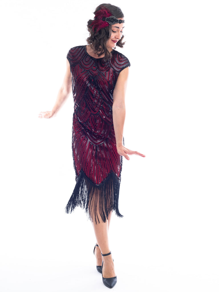 An action view of a vintage red 1920s Flapper Dress with black beads