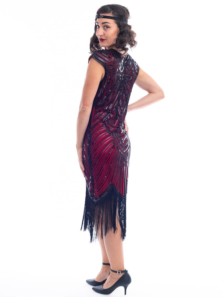 A back view of a vintage red 1920s Flapper Dress with black beads