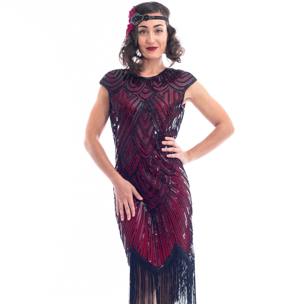 A close view of a vintage red 1920s Flapper Dress with black beads