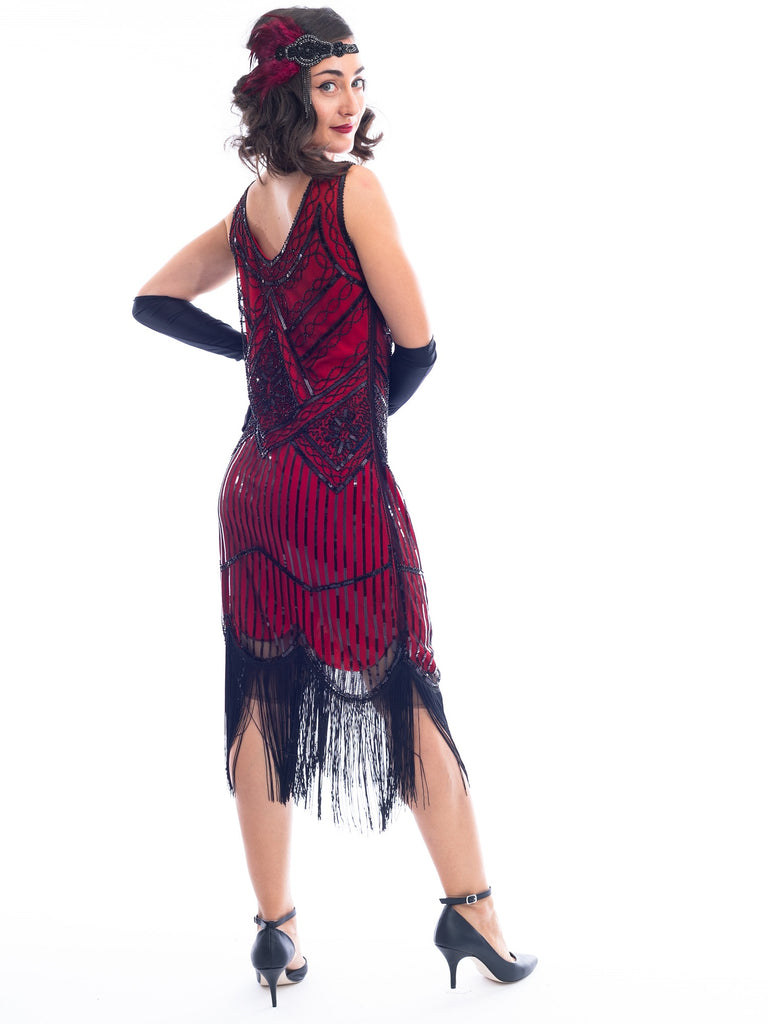 A back view of a Red 1920s Flapper Dress with black beads & fringes around the hem
