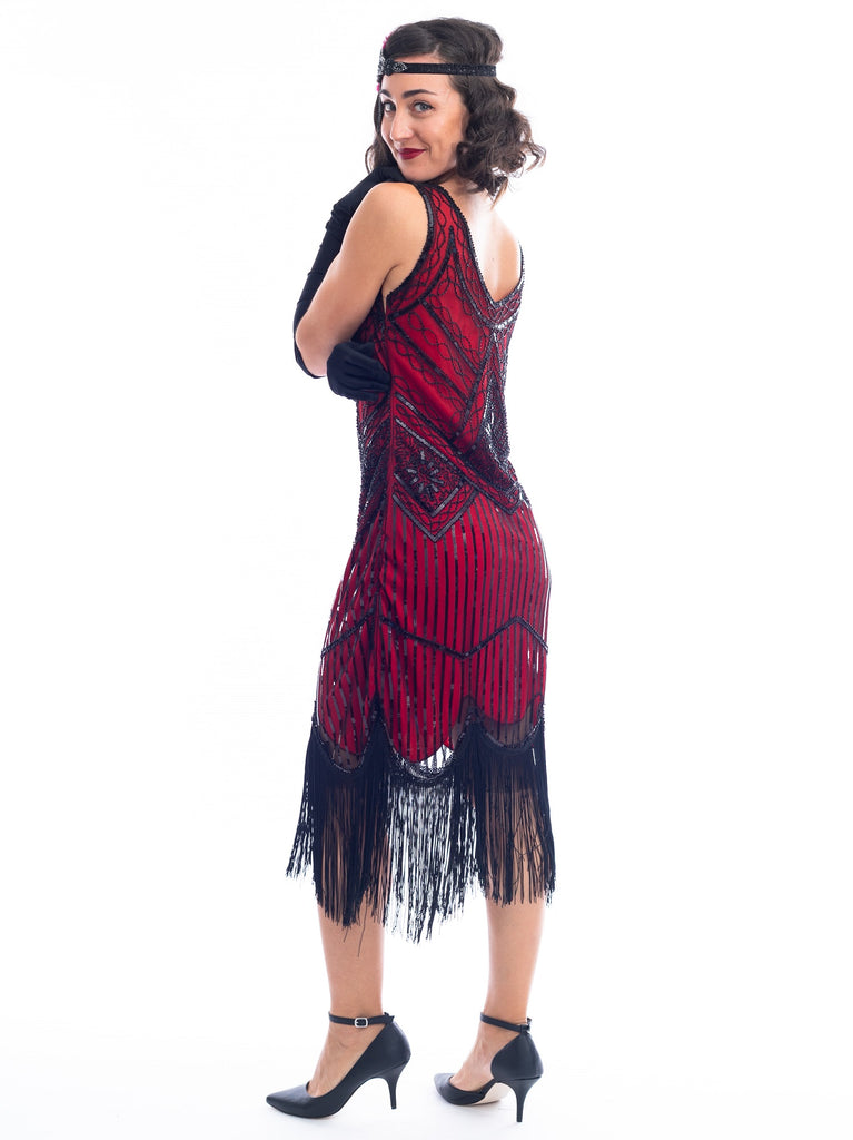 A side view of a Red 1920s Flapper Dress with black beads & fringes around the hem