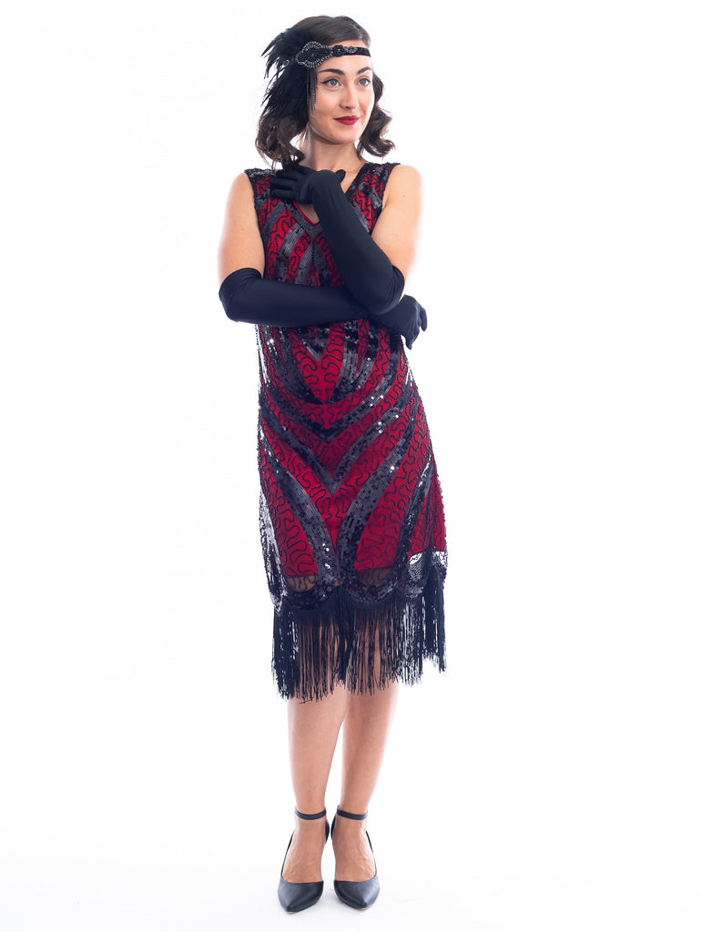 A Red Gatsby Dress with a deco pattern of black sequins, scrawls of black beads and fringe around the hem