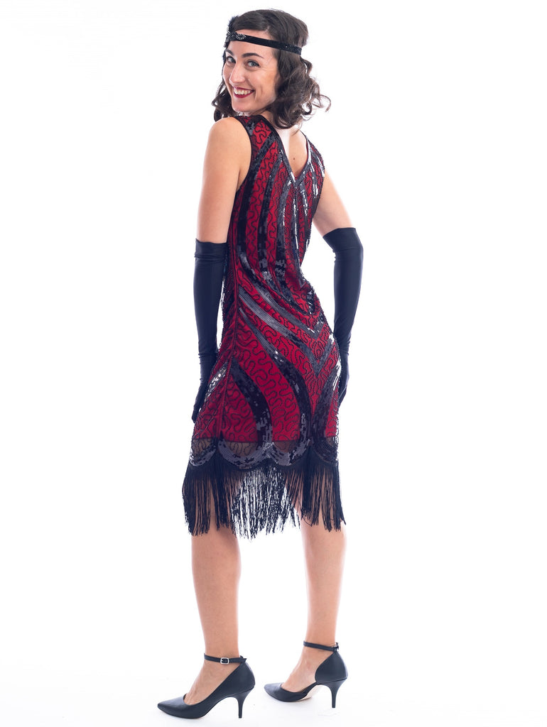 A back view of a Red Gatsby Dress with a deco pattern of black sequins, scrawls of black beads and fringe around the hem
