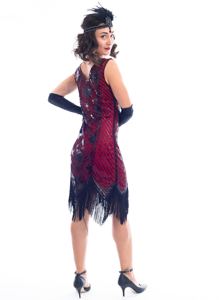 A back view of a Red Flapper Dress with a floral & geometric pattern of black sequins & beads