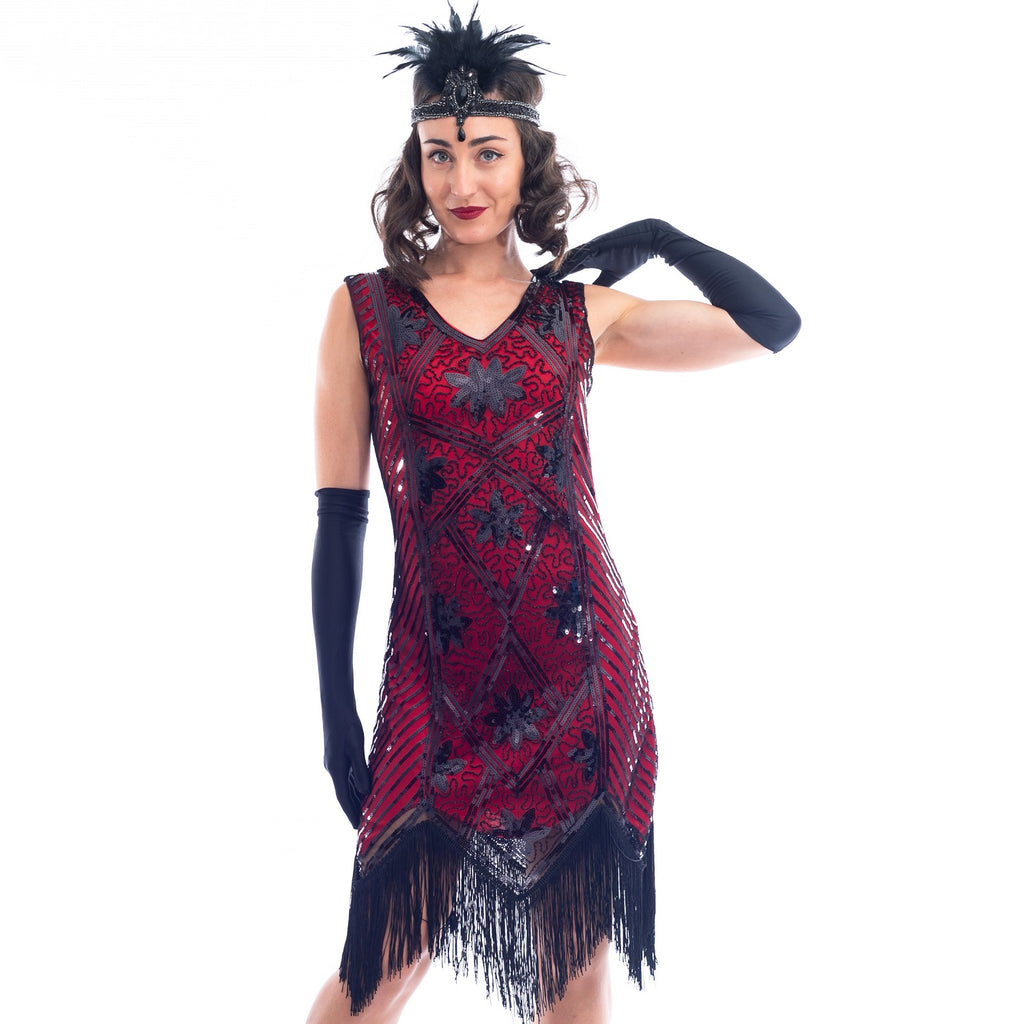 A close view of a Red Flapper Dress with a floral & geometric pattern of black sequins & beads