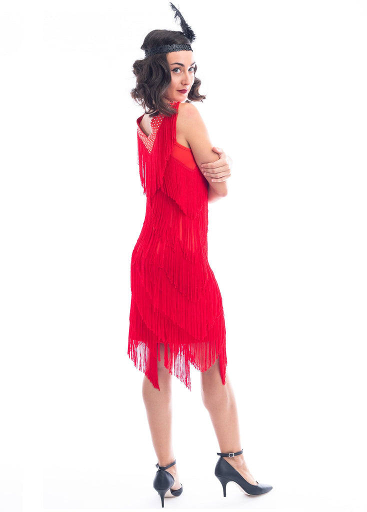 A Side View of a Red 1920s Flapper Dress with red fringes around entire dress and a v-neckline with shimmering diamantes.