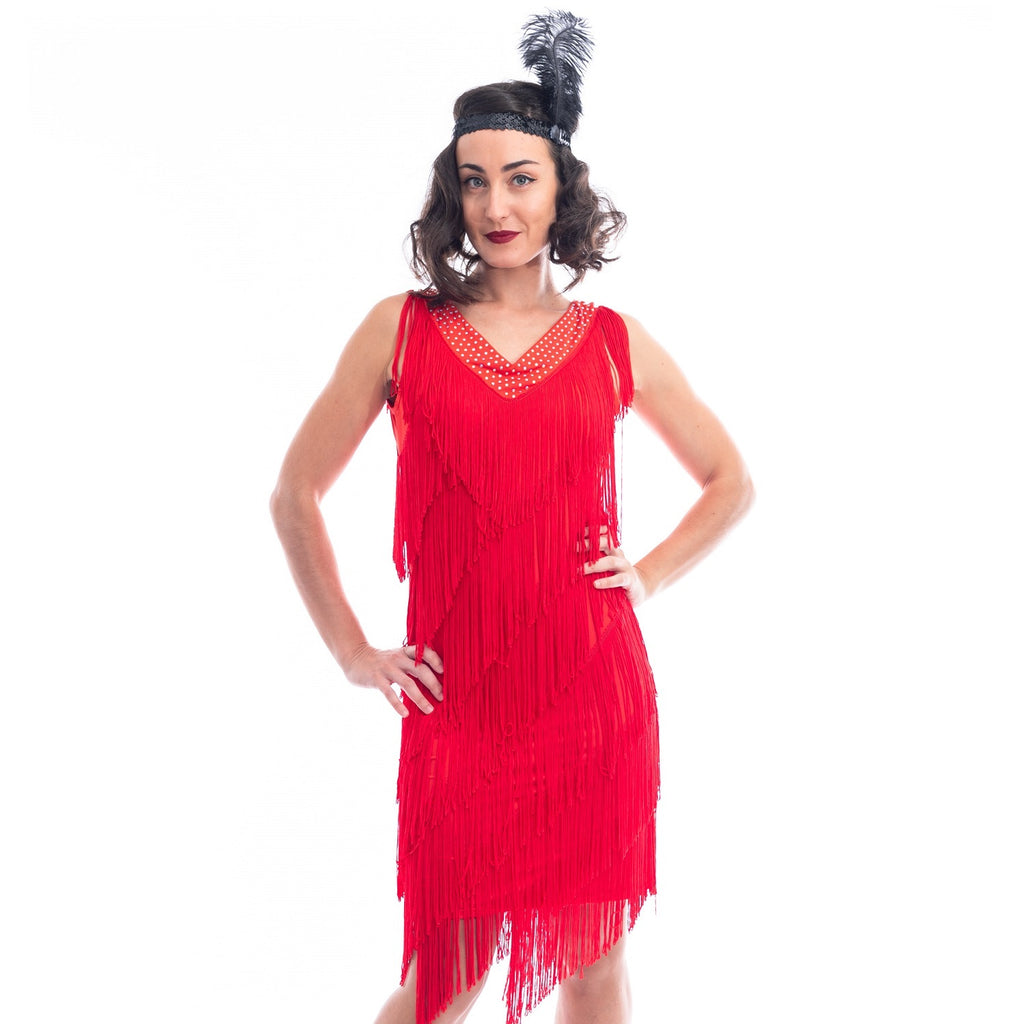 A Close View of a Red 1920s Flapper Dress with red fringes around entire dress and a v-neckline with shimmering diamantes.