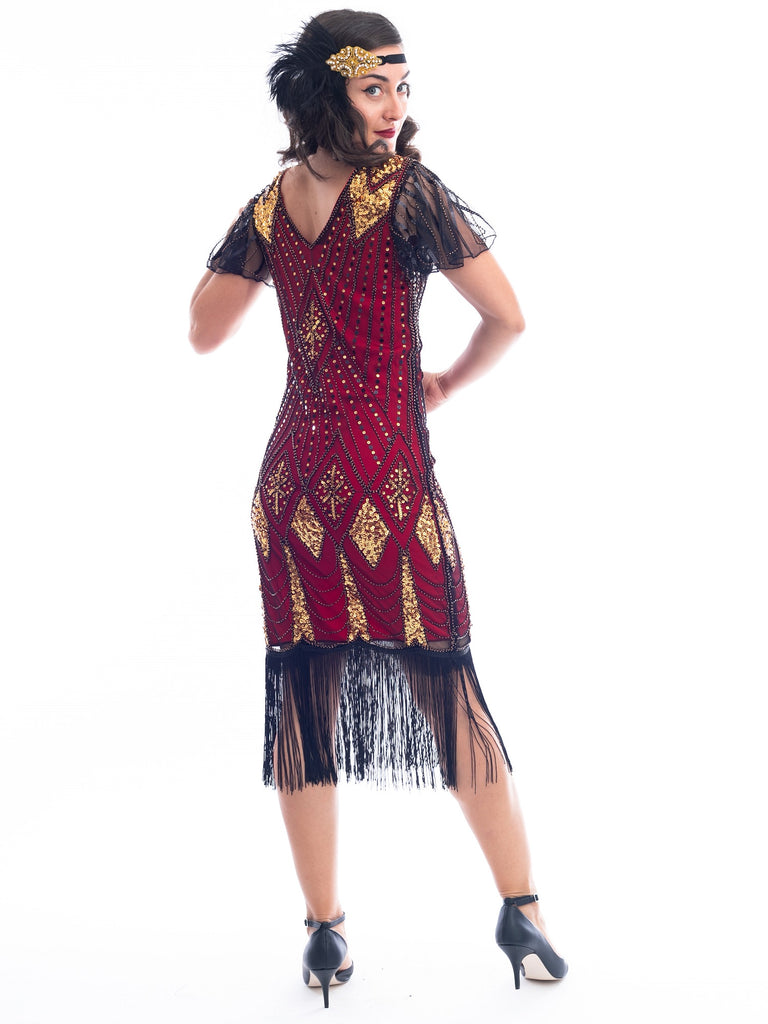 A back view of a vintage red 1920s Flapper Dress with gold beads & black sequins