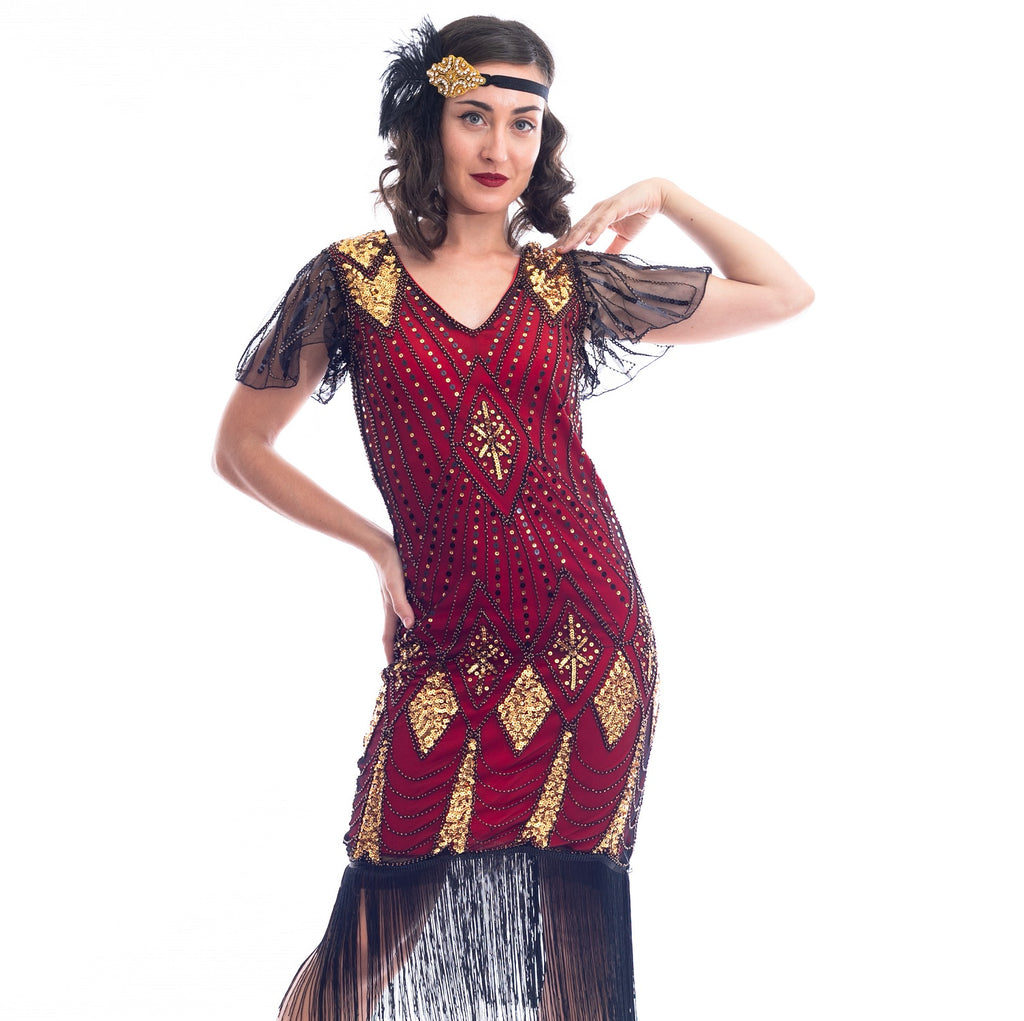 A close view of a vintage red 1920s Flapper Dress with gold beads & black sequins