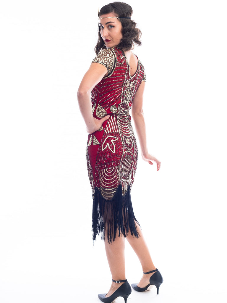 A back view of a Red 1920s Gatsby Dress with gold beads, gold sequins and black fringes around hem