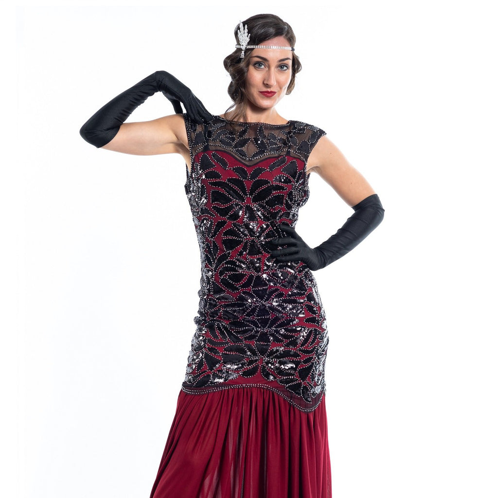 A long red flapper dress with black sequins and silver beads