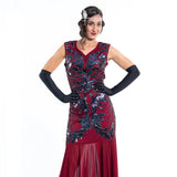 A long red gatsby dress with black sequins and silver beads