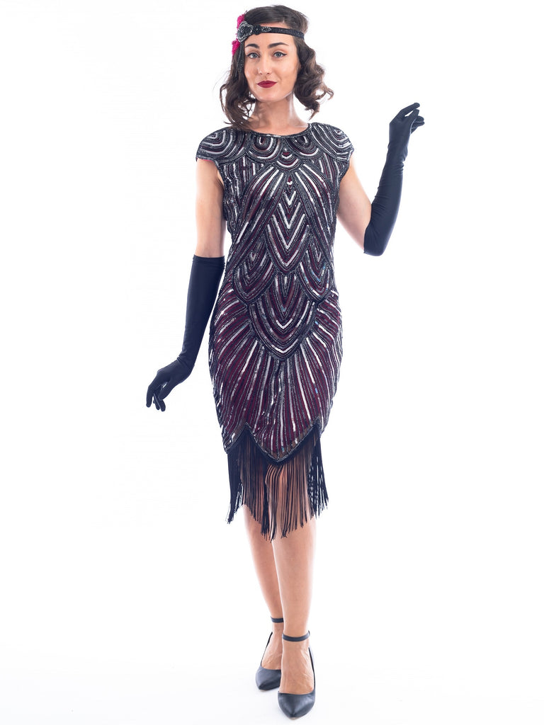 A Red 1920s Flapper Dress with silver sequins and black gloves.
