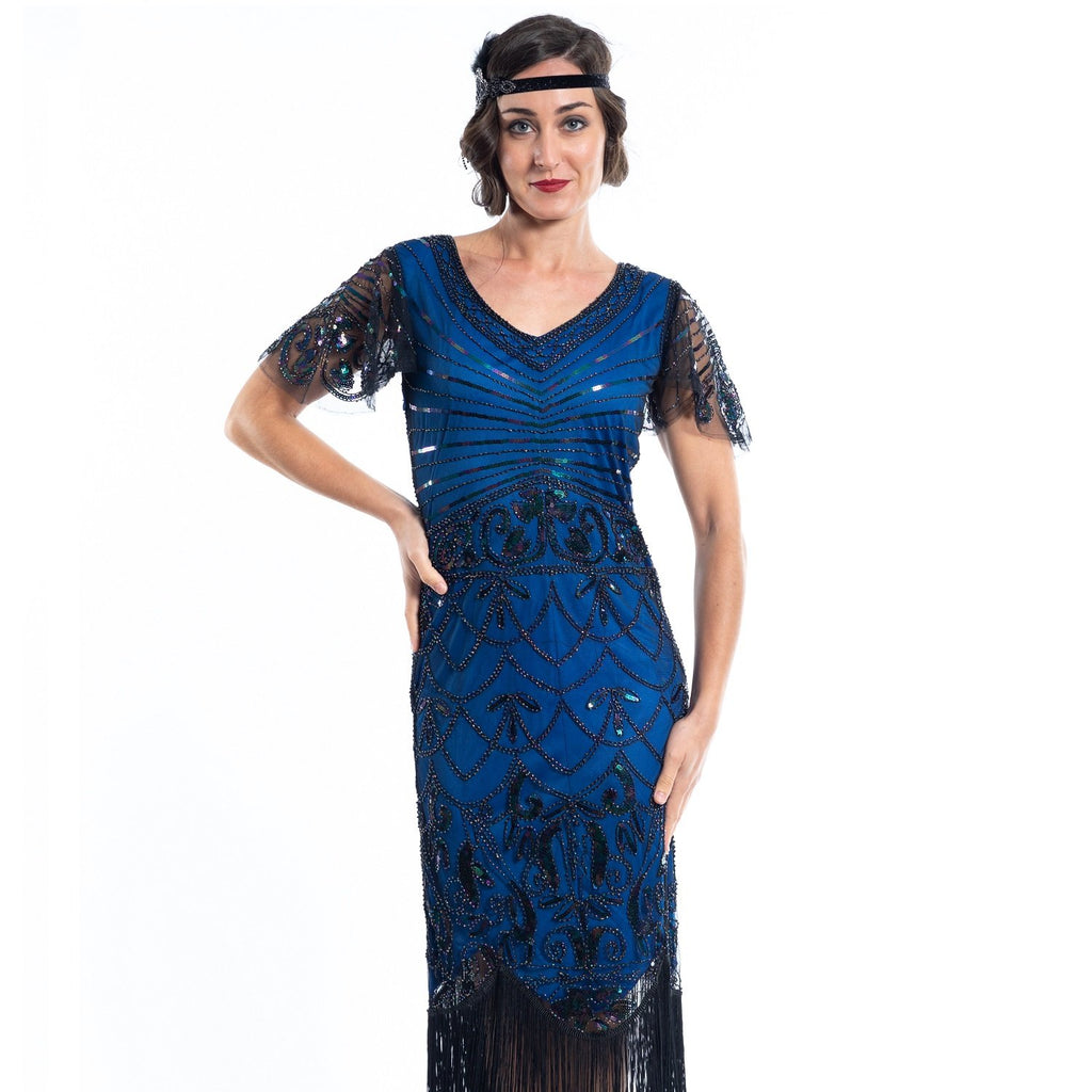 A blue gatsby dress with black beads and short sleeves