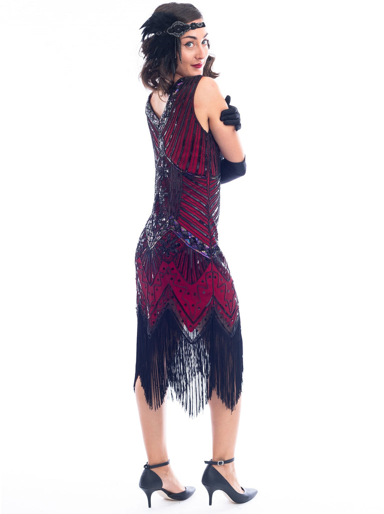 A back view of a Vintage Red 1920s Flapper Dress with black beads, black sequins & fringes around the hem