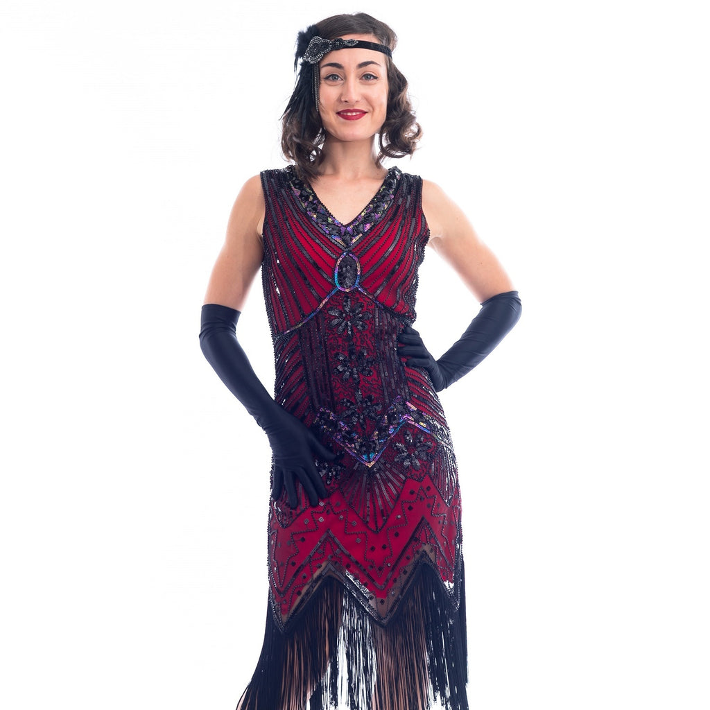 A close view of a Vintage Red 1920s Flapper Dress with black beads, black sequins & fringes around the hem
