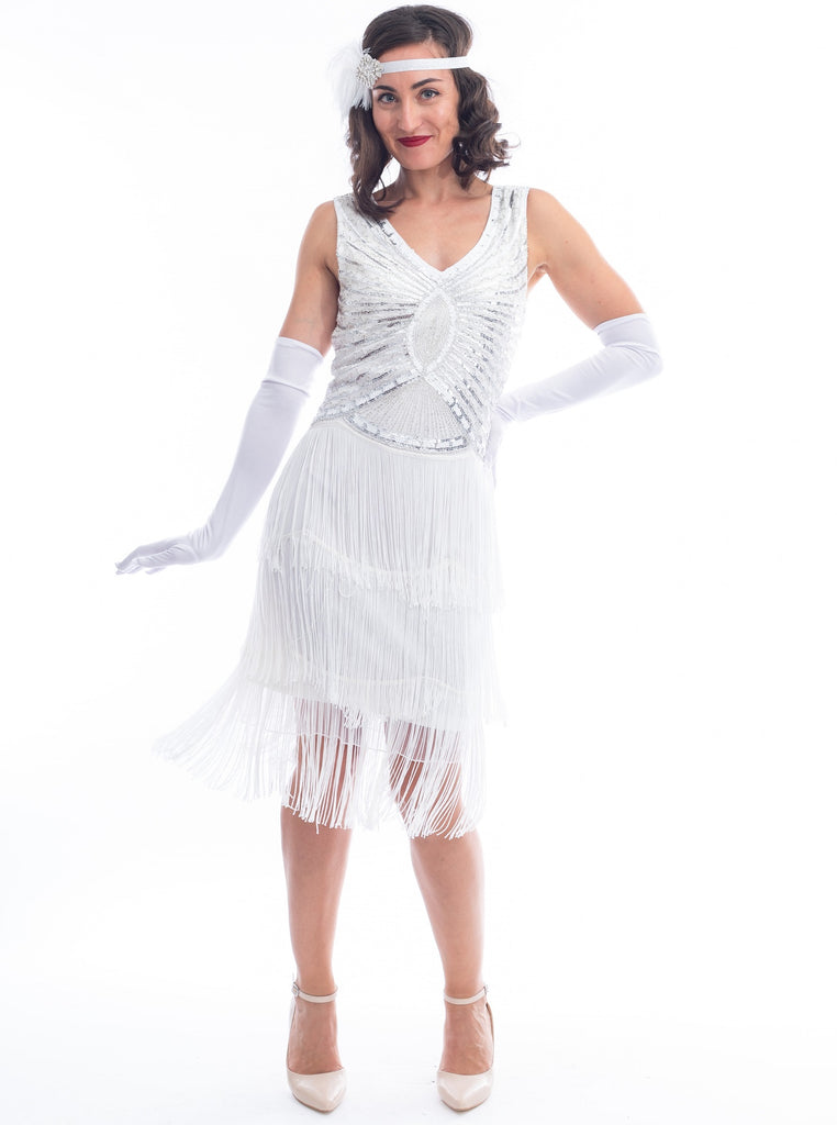A vintage white gatsby dress with white beads, sequins and fringes around hem.