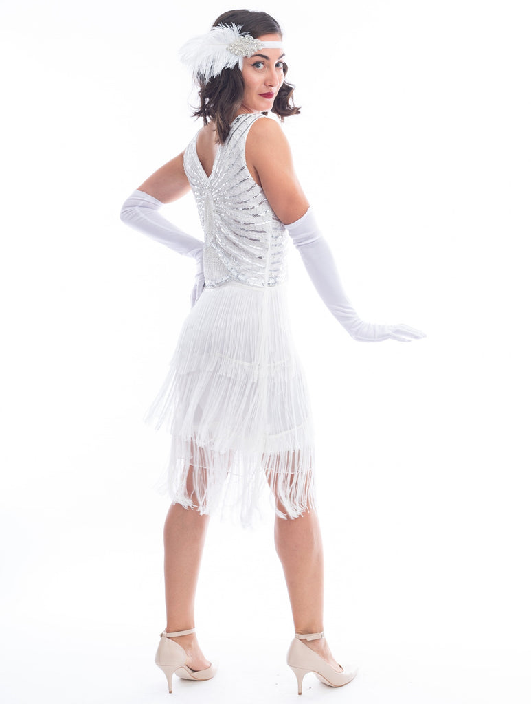 A back view vintage white gatsby dress with white beads, sequins and fringes around hem.