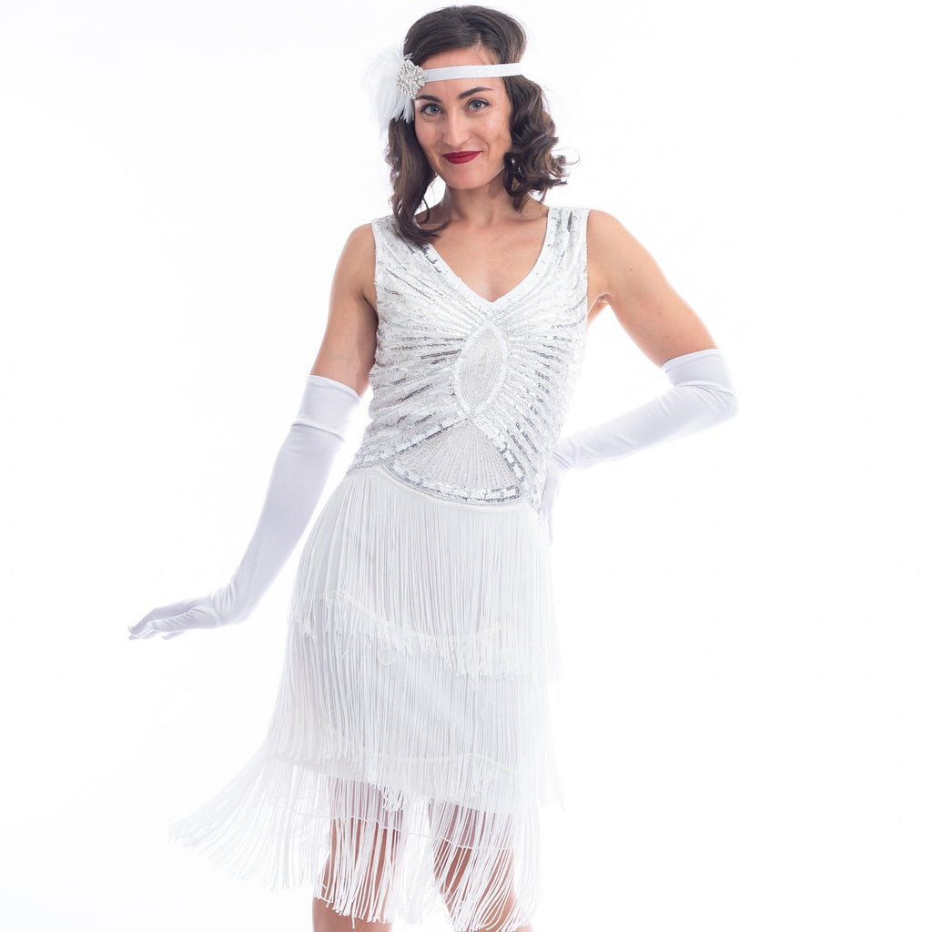 A close view vintage white gatsby dress with white beads, sequins and fringes around hem.