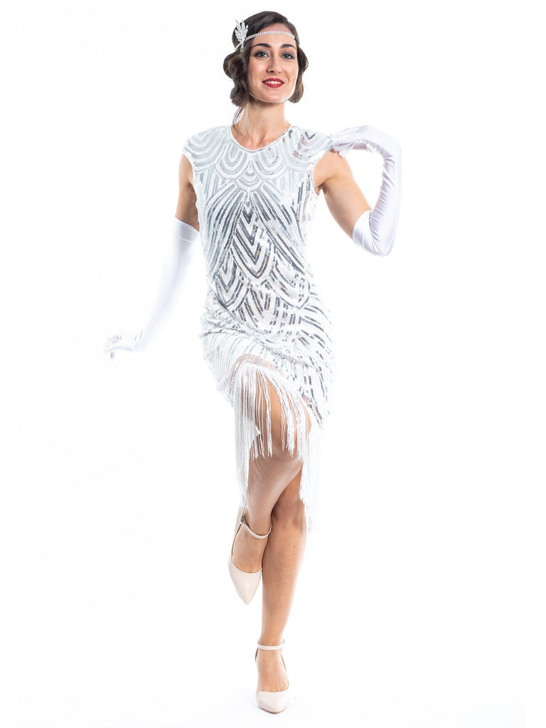 A white flapper dress with silver sequins, beads and white fringes around the hem. Model wearing white gloves